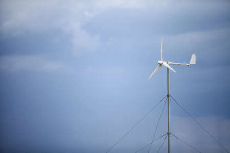 wind mill: Color image of a wind vane on a cloudy day.