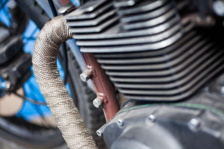 cylinders: Detail of a motorcycle exhaust pipes and cylinders.