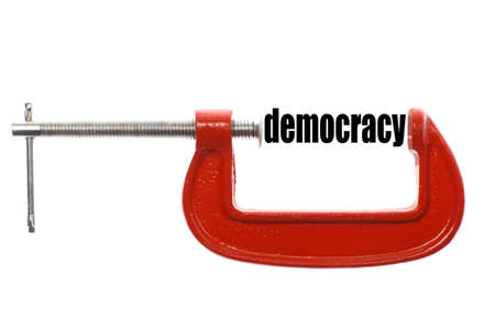 political system: The word democracy is compressed with a vice.