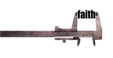 faithful: Color horizontal shot of a caliper and measuring the word faith. Stock Photo
