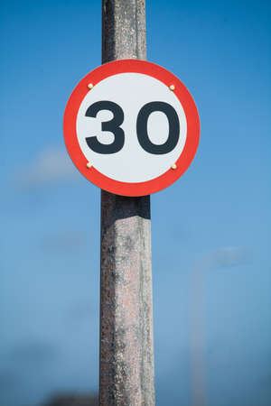 restrictive: Color image of a 30kmh speed restriction road sign. Stock Photo