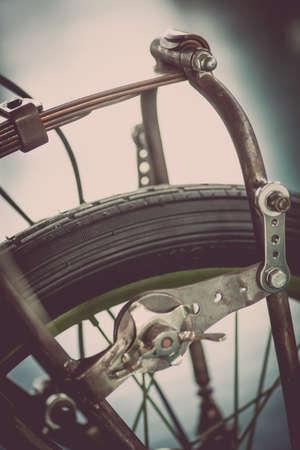 damper: Color shot of a vintage motorcycle front fork shock absorber. Stock Photo