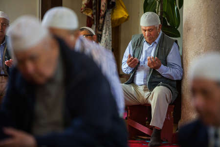 pious: Mangalia, Romania - May 27, 2016: Muslims hold their Friday prayer at the mosque in Mangalia, Romania.