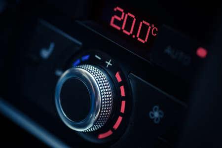 Close up shot of a cars air conditioner adjustment knob.