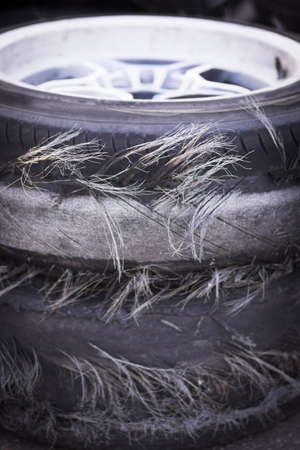 blown: Close up shot of a pile of blown out tires. Stock Photo