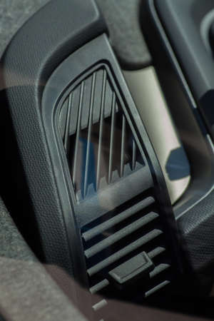 vent: Close up shot of the air vent from a car.