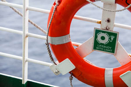 Color image of a lifebuoy on a boat.
