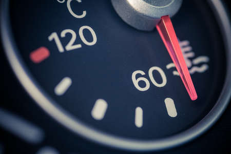 Color close up image of a cars coolant temperature gauge. Stock Photo