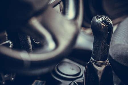 Close up shot of a cars gear shifter.