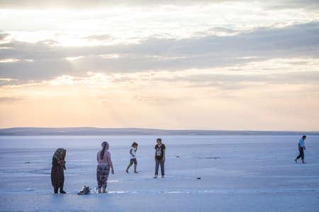 golu: Lake Tuz, Turkey - September 25, 2016: Color image of people walking on Tuz salt lake in Turkey. Lake Tuz (Tuz Golu) is one of the largest hypersaline lakes in the world.