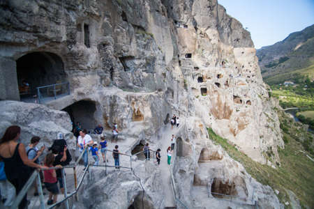 dwellings: Vardzia, Georgia - September 21, 2016: Color image of some cave dwellings in Vardzia, Georgia and some tourists.