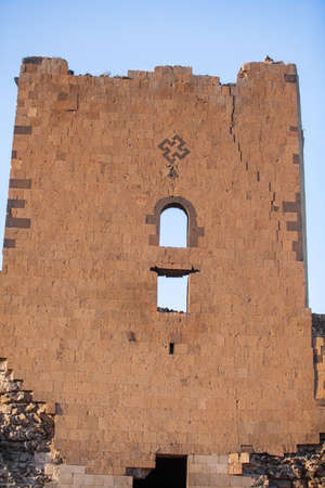 swastika: Swastika mark on a wall in Ani, Turkey. Ani used to be the capital of the Bagratid Armenian kingdom, between 961 and 1045.