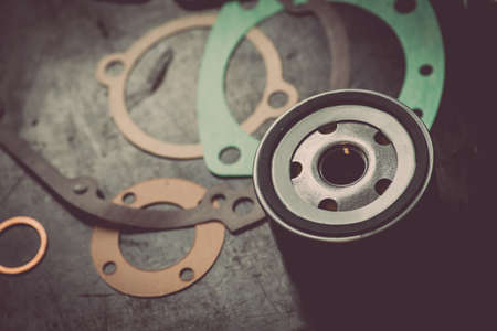 sealing ring: Close up shot of various engine gaskets and an oil filter. Stock Photo