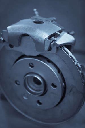 brake caliper: Close up image of a cars brake disk and caliper. Stock Photo