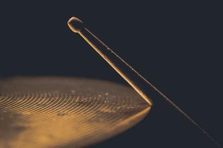 Close up shot of a drumstick hitting a cymbal. Stock Photo