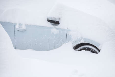 climatic: Color image of a parked car, under heavy snow. Stock Photo