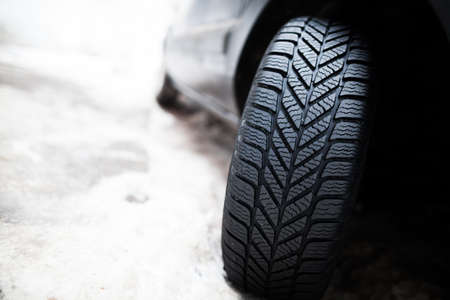 Close up shot of a cars winter tire.