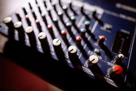 Close up shot of a mixer desk with many buttons. Stock Photo