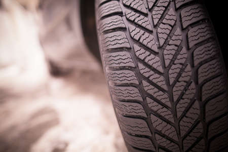 winter tires: Close up shot of a cars winter tire.