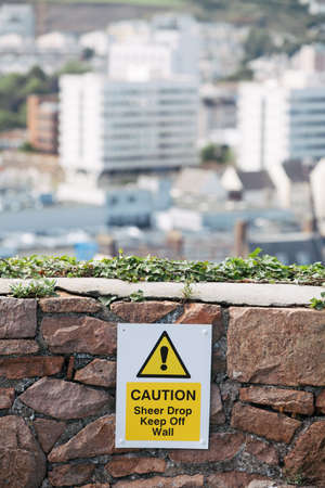 Detail shot of a waning sign on a wall. Stock Photo