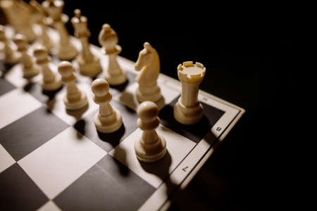 pawns: Image of the white pieces on a chess board, with shallow depth of field.