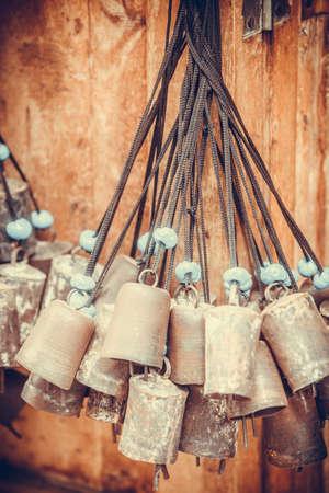Color image of some old bells, hanging.
