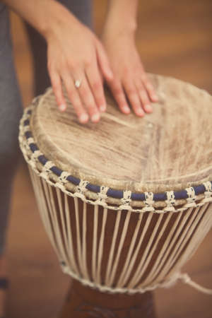 Close up shot of a bongo drum and a hand. Stock Photo