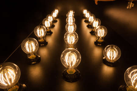 Close up shot of some light bulbs displayed on a table.