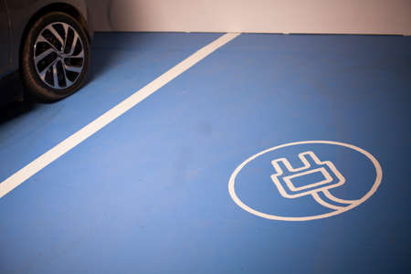 Color shot of a parking place for charging electric cars. Фото со стока