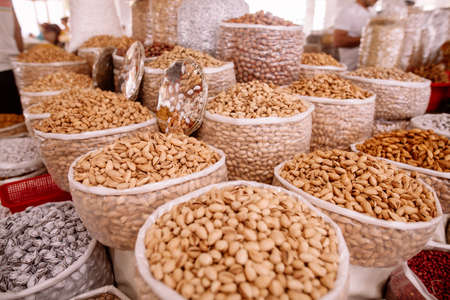 Various seeds for sale in a market.