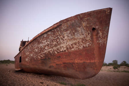 Color image of a wrecked ship, on the former banks of the Aral sea in Moynaq, Uzbekistan.