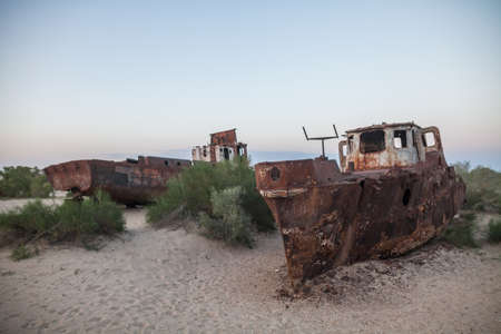 Color image of some wrecked ships, on the former banks of the Aral sea in Moynaq, Uzbekistan.
