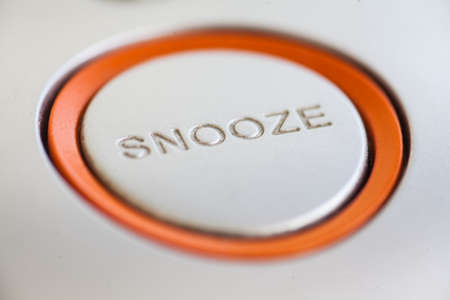 Close up shot of a snooze button of an electronic clock.