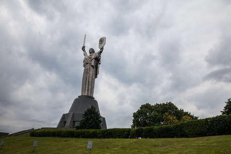 Soviet Motherhood statue with shield and sword, against a cloudy sky, in Kiev Ukraine. Stock fotó - 108087910