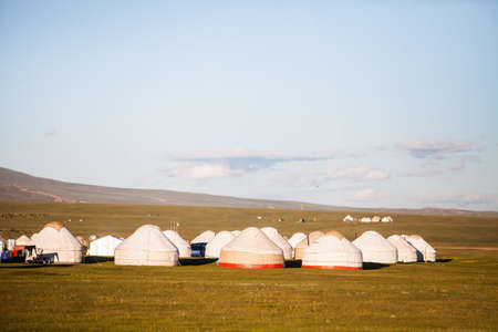 Evening shot of some yurts on a meadow in Kyrgyzstan. Stock fotó