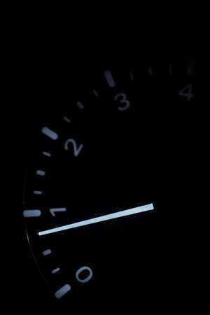 Close up shot of the rev counter of a car.