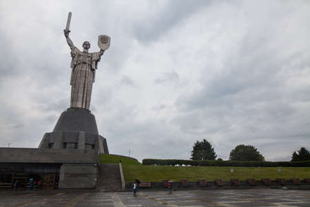 Soviet Motherhood statue with shield and sword, against a cloudy sky, in Kiev Ukraine. Stock fotó - 116900217