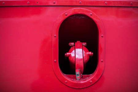 Close up shot of an old bus tank fill cap.