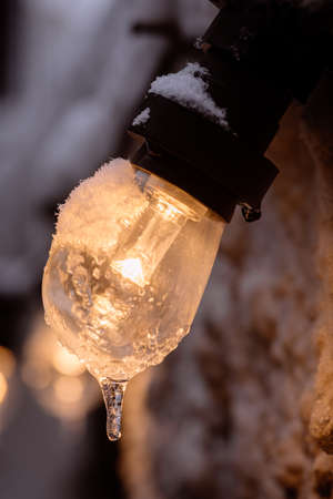 Color image of a frozen lit light bulb.