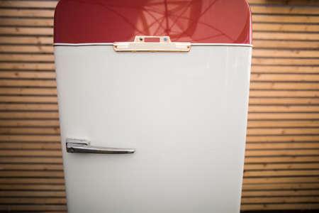 Close up shot of a vintage refrigerator.