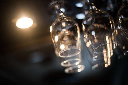 Some hanging wine glasses in a pub.