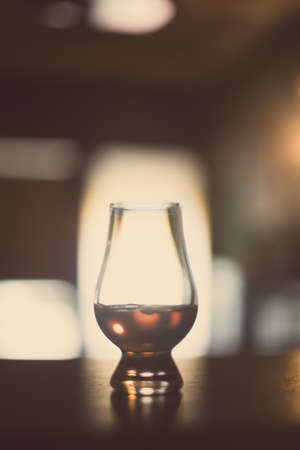 Close up shot of a Glencairn whisky glass.