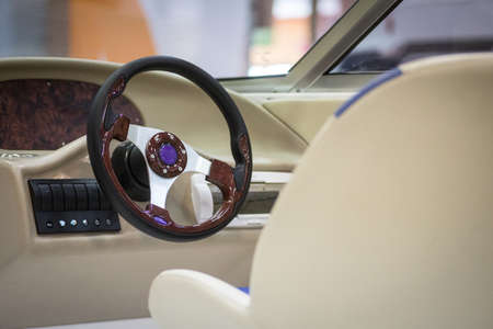 Color image of a speed boat steering wheel.