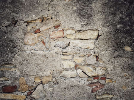 Color image of a cracked brick wall.