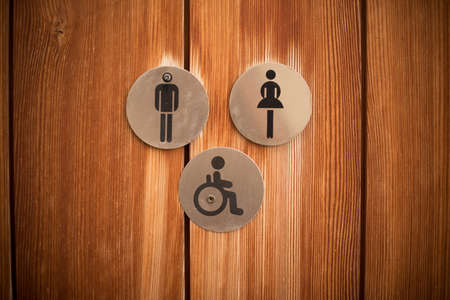Signs for a wc entrance, icons for disabled persons on wheelchairs. 版權商用圖片