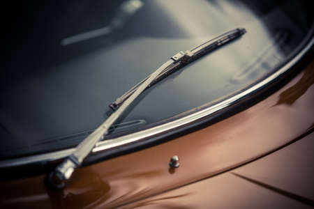 Close up shot of vintage car windscreen wipers. 免版税图像