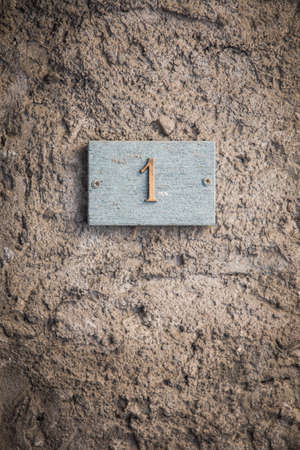 House number with number one, on a wall.