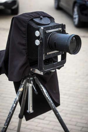 Close up shot of a vintage camera on a tripod.