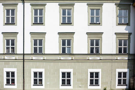 Image of many windows on a building facade on a sunny day. 写真素材