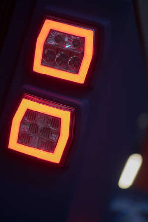 Close up horizontal image of the LED tail lights of a new sport super car. Stock Photo